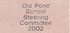 Old Pona School Steering Committee 2002 writing on brick