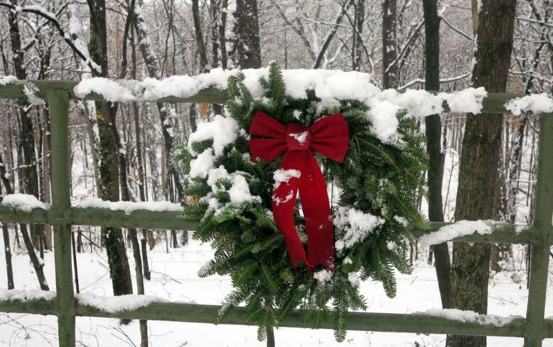 December Image for 2020 Calendar - photo of a wreath on a fence in the snow