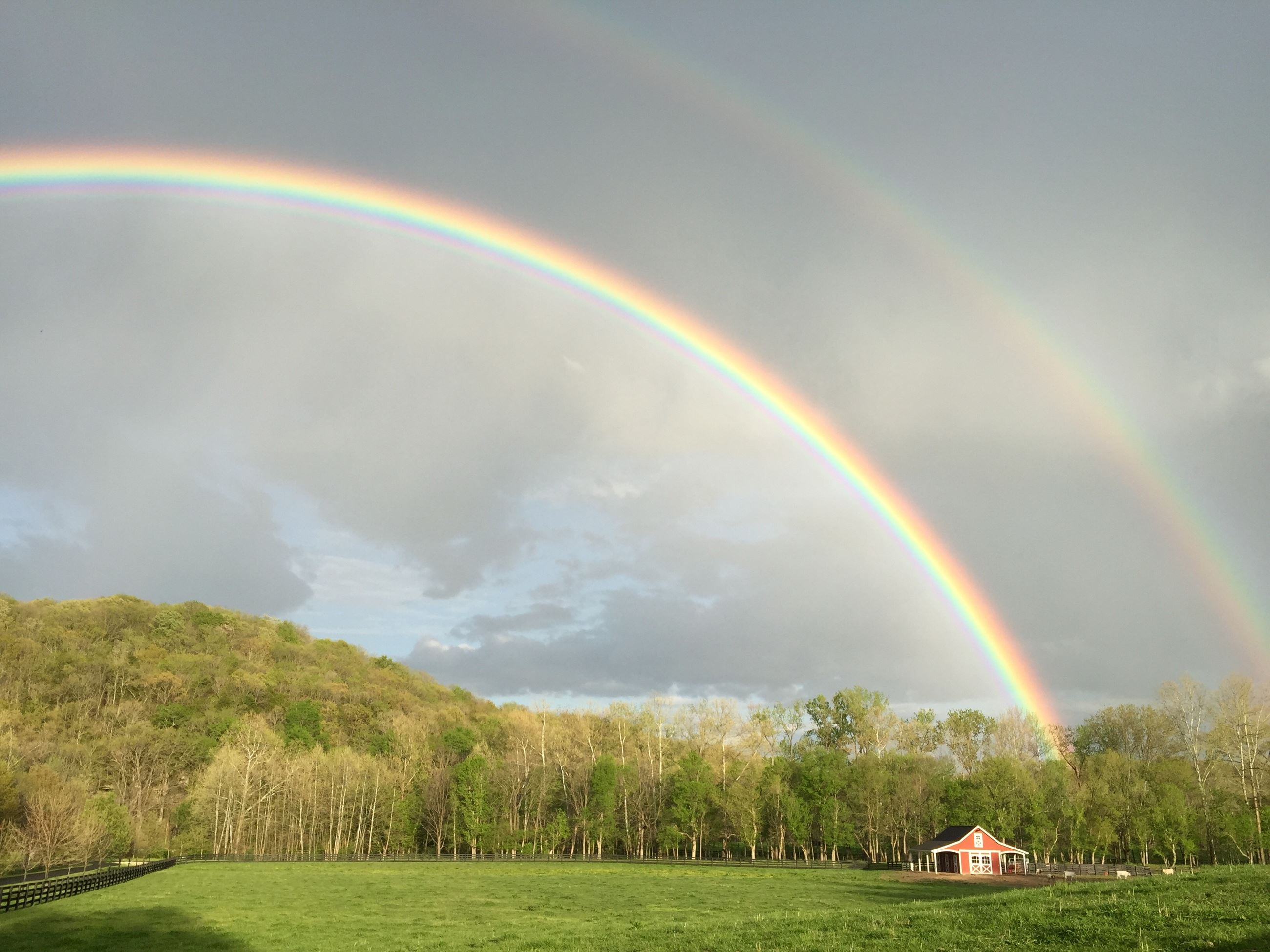 April 2017 Calendar Photo double rainbow over a barn